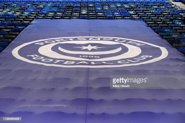 The Portsmouth FC logo is seen on a banner inside the stadium prior to the Sky Bet League One match between Portsmouth and Lincoln City at Fratton...