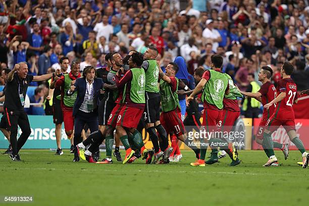 The Portugal players celebrate Eder's goal in extra time to make the score 10 during the UEFA Euro 2016 Final match between Portugal and France at...