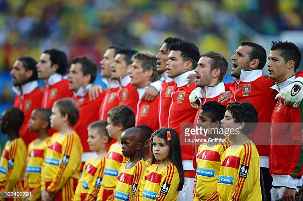 The Portugal team line up for the national anthems prior to the 2010 FIFA World Cup South Africa Group G match between Portugal and Brazil at Durban...