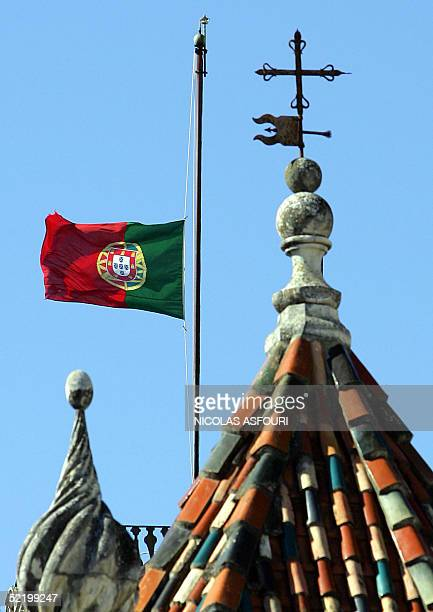 The Portuguese flag seen on the top of Coimbra university flies at half mast as Portugal is mourning the death of Sister Lucia in Coimbra 15 February...