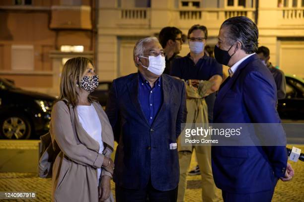 The Portuguese Prime Minister Antonio Costa talks with concert promoter Alvaro Covoes as they wait in line to enter Campo Pequeno to see Deixem o...