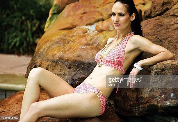 The pose may be relaxed but this style is as hot as the water below this rockrimmed Jacuzzi It all starts with an orange latticeprint bikini from...