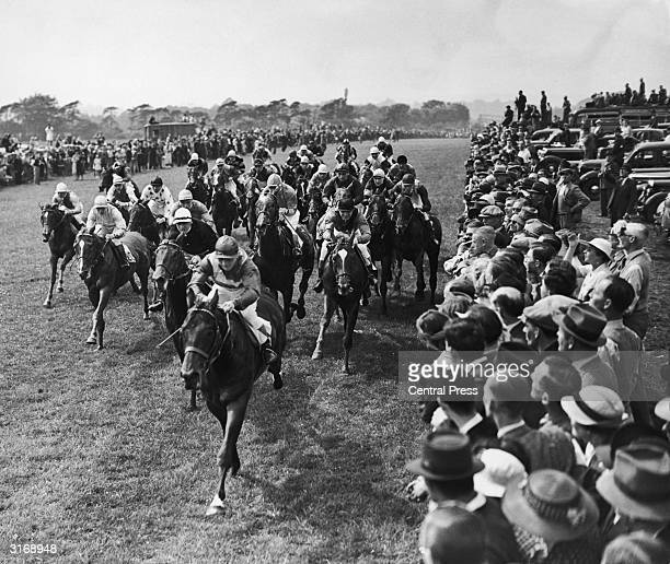 The position at the Mile Post in the Derby run at Epsom in Surrey The race was won by Blue Peter ridden by Eph Smith