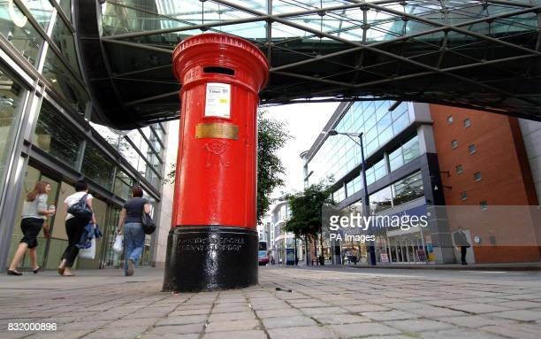 The post box that has become an icon of the IRA Manchester explosion as it stood undamaged amongst the destruction of the blast and stands today with...