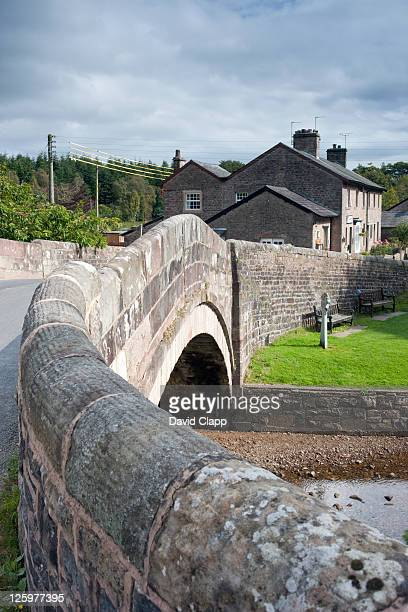 the post office and the bridge of the dunsop river at dunsop bridge in the forest of bowland, lancashire, england, uk - lancashire stock pictures, royalty-free photos & images