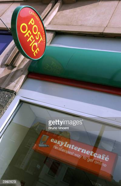 The Post Office Ltd sign is seen hanging outside a branch August 13 Camden High Street, London. Easyinternetcafe and the Post Office have joined...