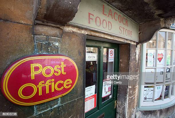 The Post Office sign is displayed outside Lacock Village Stores and Post Office on March 19 2008 in Lacock United Kingdom The village Post Office has...