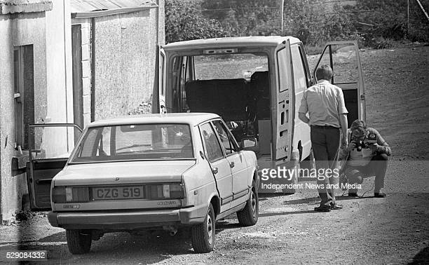 The Post Office van and the unmarked Garda car in which Detective Garda Frank Hand was killed in during the raid on the Drumree Post Office Co Meath...