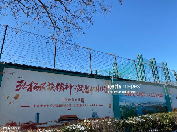 The posters on the wall alongside the Qingdao Taekwang Shoes Co factory the side where the Uighur workers enter and exit and live in dorms which...