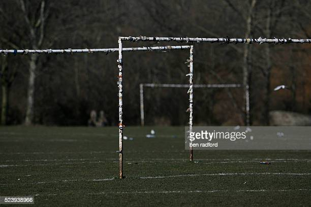 The posts and crossbars of each goal are covered with tape the preferred method of attaching each team's own net to the goal during Sunday morning...
