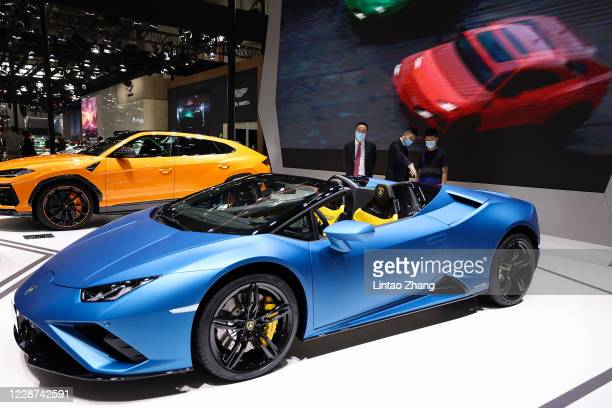 The potential consumers look at a Lamborghini car during 2020 Beijing International Automotive Exhibition at China International Exhibition Center on...