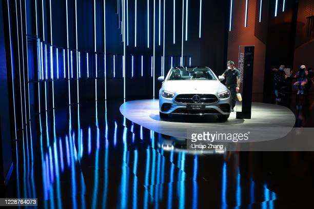 The potential consumers look at a Mercedes Benz -E350L 4Matic Sport Sedan car during the 2020 Beijing International Automotive Exhibition at China...