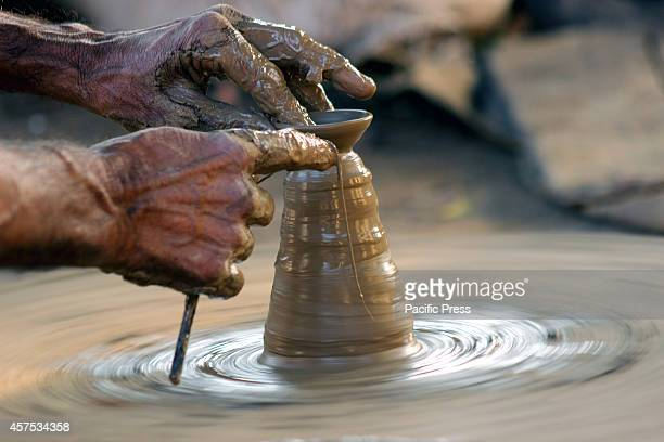 The potter prepares the earthen lamps also called diyas ahead of Diwali festival It is approximately 6 to 7 hours for this process to be completed...