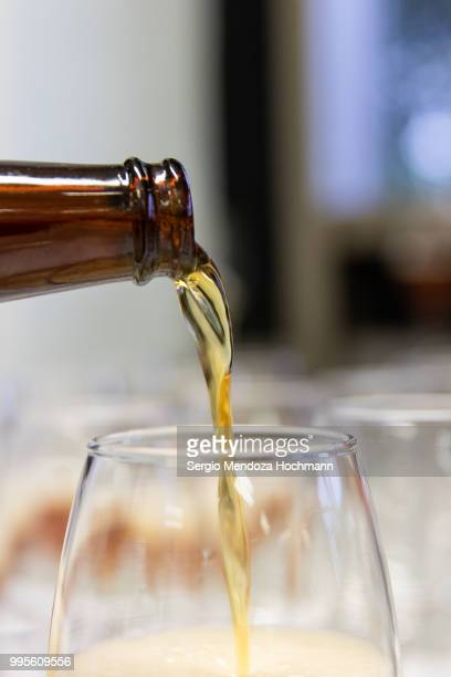 the pouring of a good mexican beer - mexican beer stock pictures, royalty-free photos & images