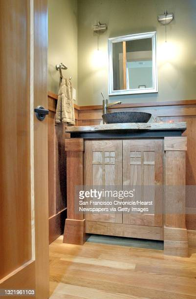 """The """"Powder Room"""" rich with Cherry Wood Cabinets. Oakland Hills modern home, that borrows from the 20's style of Arts and Crafts architecture. For..."""