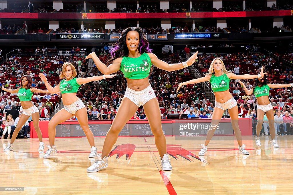 The Power Dancers of the Houston Rockets perform during a game against the Golden State Warriors on March 17, 2013 at the Toyota Center in Houston, Texas.