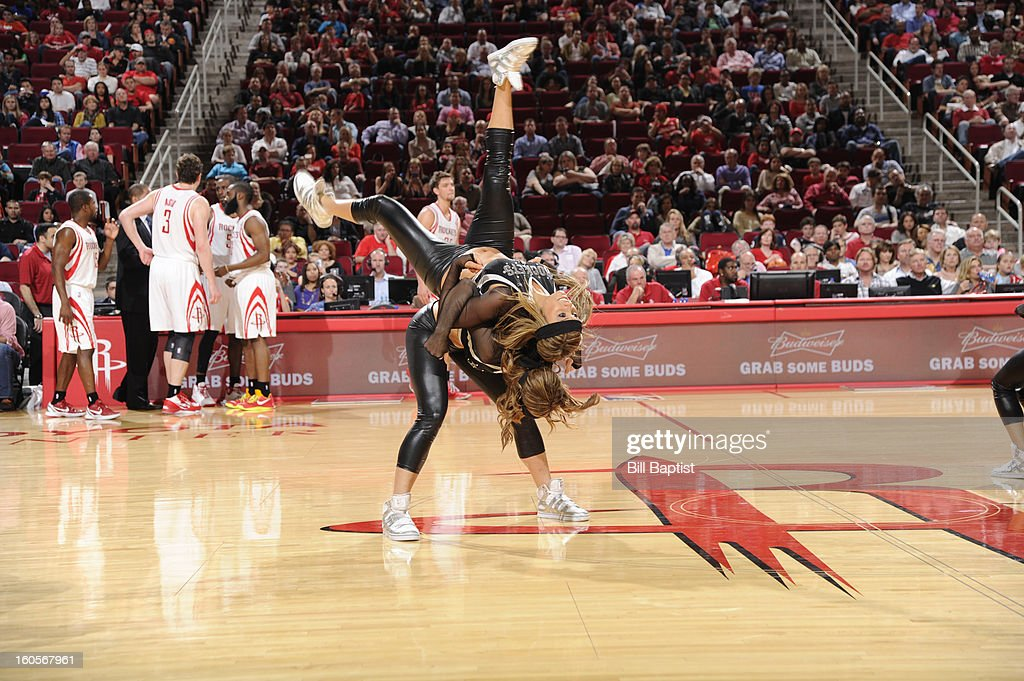 The Power Dancers of the Houston Rockets perform during the game against the Charlotte Bobcats on February 2, 2013 at the Toyota Center in Houston, Texas.