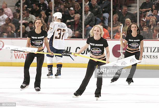 The Power Play girls of the Anaheim Ducks clean the ice wearing vote for ducks tshirts to promote the All Star ballot for the NHL during the game on...