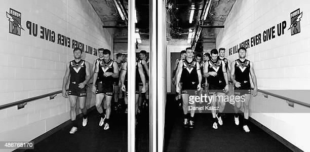 The Power players make their way into the changrooms after the round 23 AFL match between the Port Adelaide Power and the Fremantle Dockers at...
