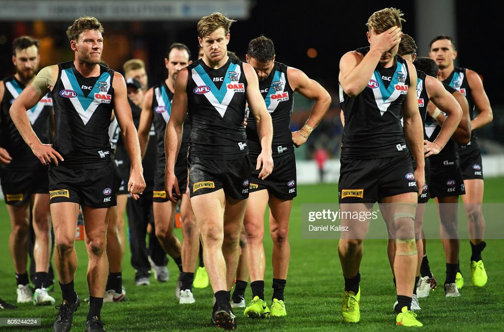 The Power players walk from the field looking dejected after being defeated by the Tigers during the round 15 AFL match between the Port Adelaide Power and the Richmond Tigers at Adelaide Oval on July 1, 2017 in Adelaide, Australia.
