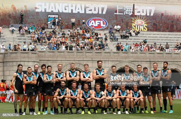 The Power pose for a team photo before the 2017 AFL round 08 match between the Gold Coast Suns and Port Adelaide Power at Jiangwan Sports Stadium on...