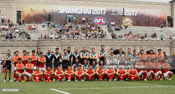 The Power pose for a team photo with Team China before the 2017 AFL round 08 match between the Gold Coast Suns and Port Adelaide Power at Jiangwan...