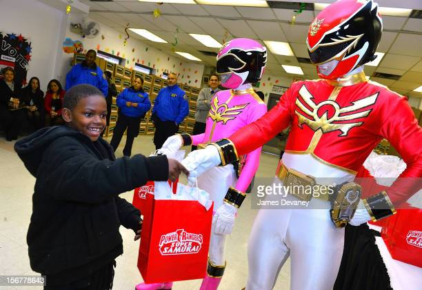 The Power Rangers deliver Thanksgiving gifts to families at HELP Bronx Morris Avenue on November 20 2012 in New York City