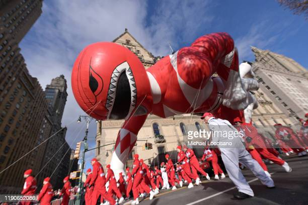 The Power Rangers Mighty Morphin Red Ranger balloon floats low down the parade route during the 93rd Annual Macy's Thanksgiving Day Parade on...