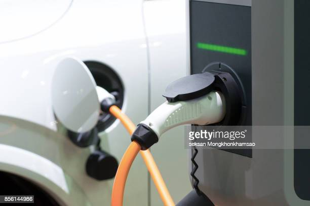 the power supply for charging of an electric car - hybrid car stock photos and pictures