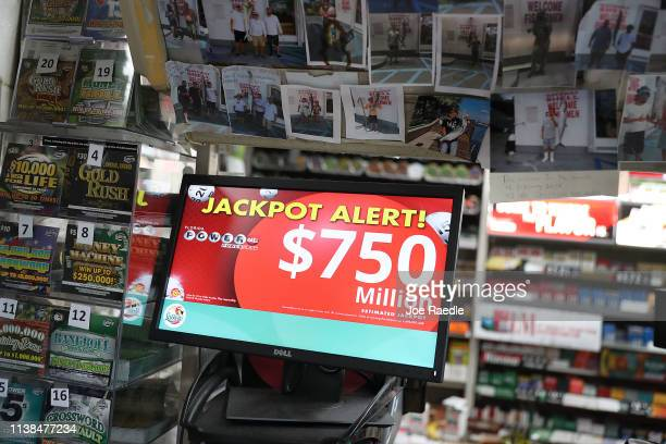 The Powerball jackpot is seen on a sign at the Shell Gateway store on March 26 2019 in Boynton Beach Florida Wednesday's Powerball drawing will be an...