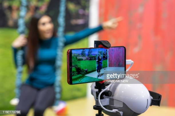 The PowerEgg X autonomous personal AI camera tracks a woman on a swing at the 2020 Consumer Electronics Show in Las Vegas, Nevada on January 9, 2020.