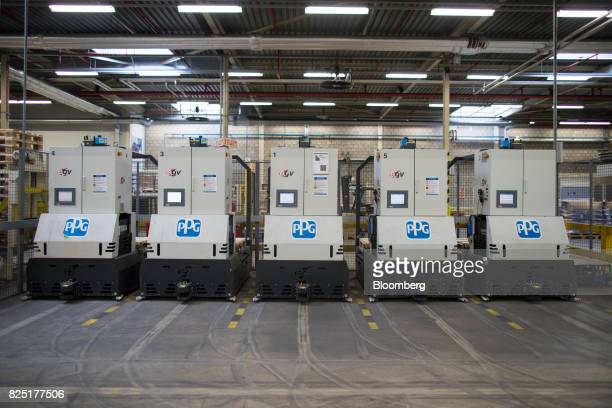 The PPG Industries Inc logo sits on automated guided vehicles inside the PPG paints and coatings factory in Amsterdam Netherlands on Tuesday Aug 1...
