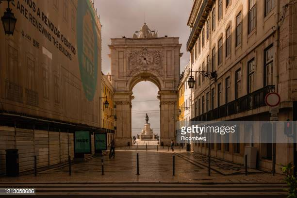 The Praca do Comercio is viewed from a deserted Rua Augusta in Lisbon, Portugal on Thursday, May 14, 2020. The European Unions executive arm pushed...