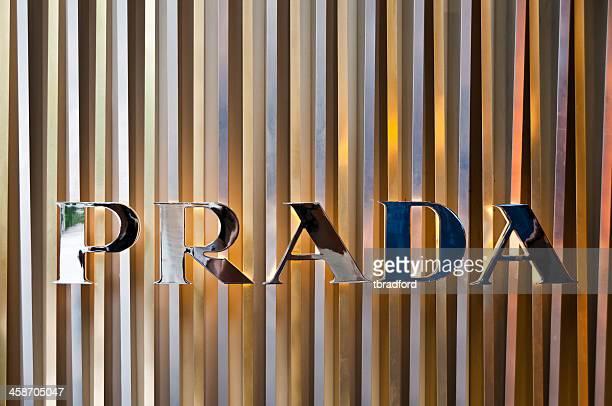 the prada logo - logo design stock photos and pictures