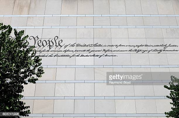 The preamble to the US Constitution is etched on a side wall of the National Constitution Center in Philadelphia Pennsylvania on August 27 2016
