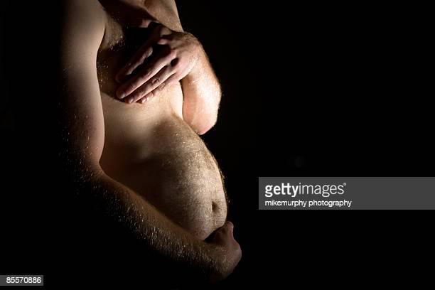the pregnant man - grossesse humour photos et images de collection