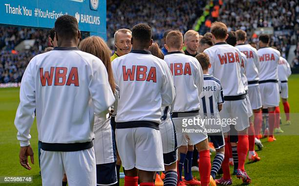 The pre-match hand shakes with West Bromwich Albion players wearing retro kit and tracksuits on Jeff Astle Day celebrating the former WBA legend who...