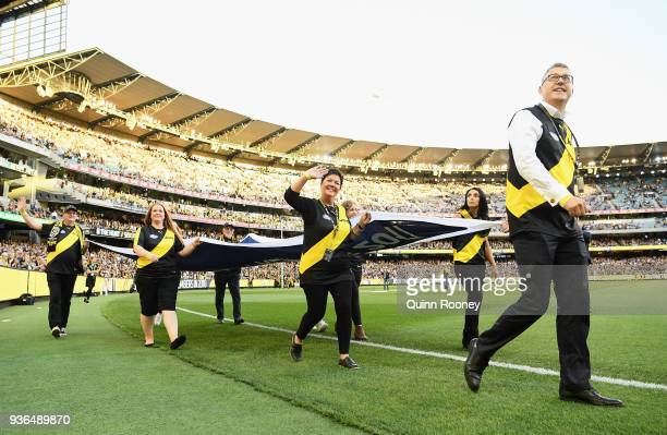 The Premeirship Flag is carried around the MCG during the round one AFL match between the Richmond Tigers and the Carlton Blues at Melbourne Cricket...
