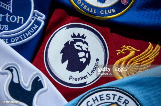The Premier League logo amongst shirts from Premier League clubs on May 14, 2020 in Manchester, England.
