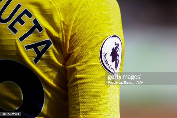 The Premier League logo branding is seen on the sleeve of Cesar Azpilicueta of Chelsea during the Premier League match between Huddersfield Town and...
