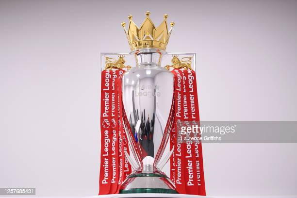 The Premier League Trophy is dressed in Liverpool Red Ribbons ready for the presentation ceremony ahead of the Premier League match between Liverpool...