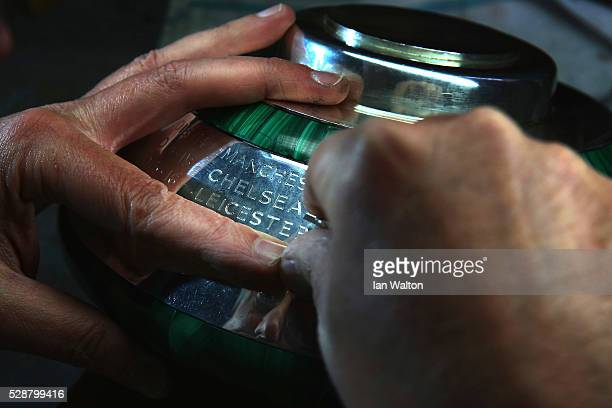 The Premier League Trophy is engraved with Leicester City's name as 2016 Champions by Philip Sale, Head engraver at Asprey on May 5, 2016 in London,...
