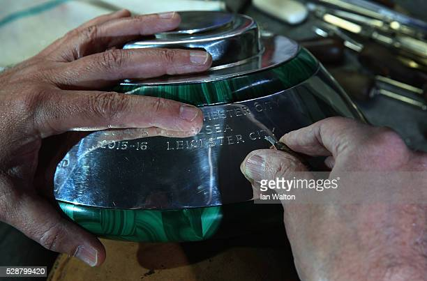 The Premier League Trophy is engraved with Leicester City's name as 2016 Champions by Philip Sale Head engraver at Asprey on May 5 2016 in London...