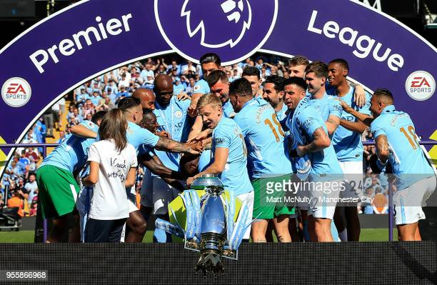 The Premier League trophy is knocked off the plinth after the Premier League match between Manchester City and Huddersfield Town at Etihad Stadium on...