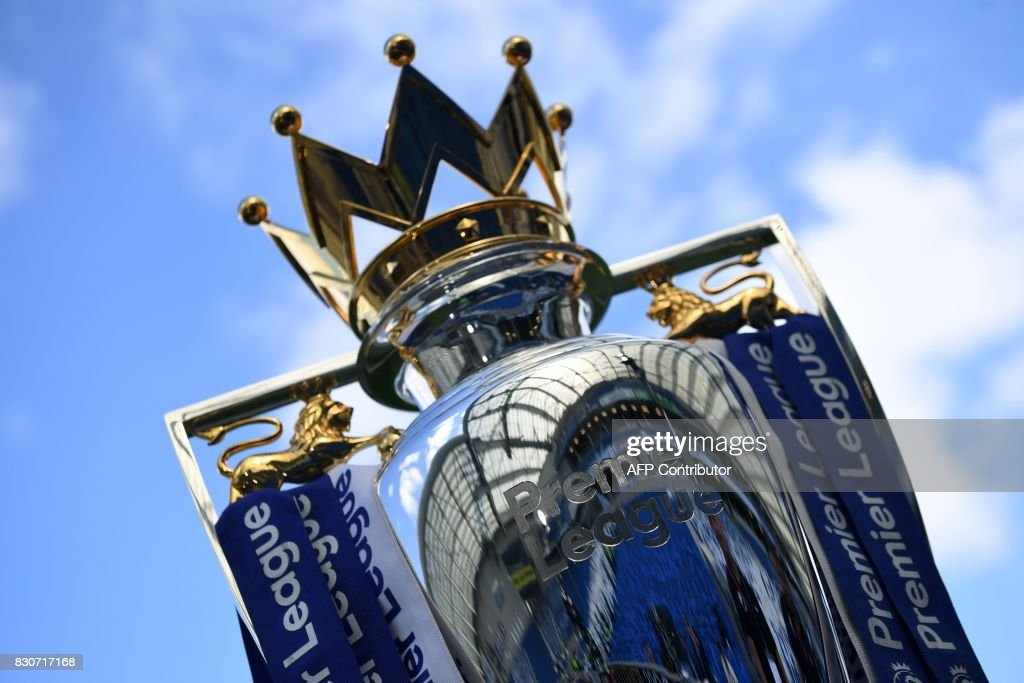 TOPSHOT - The Premier league trophy is pictured beneath the blue sky ahead of the English Premier League football match between Brighton and Hove Albion and Manchester City at the American Express Community Stadium in Brighton, southern England on August 12, 2017. / AFP PHOTO / CHRIS J RATCLIFFE / RESTRICTED TO EDITORIAL USE. No use with unauthorized audio, video, data, fixture lists, club/league logos or 'live' services. Online in-match use limited to 75 images, no video emulation. No use in betting, games or single club/league/player publications. /