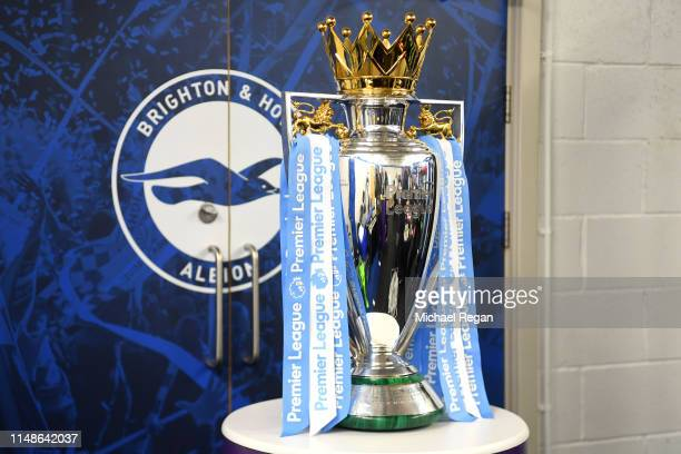 The Premier League trophy is prepared during the Premier League match between Brighton & Hove Albion and Manchester City at American Express...