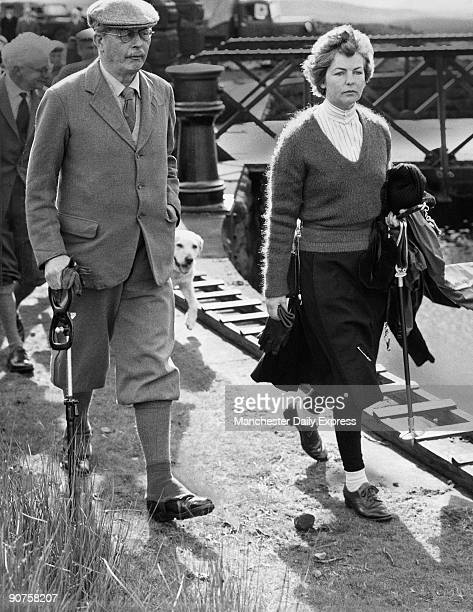 �The Premier Mr Macmillan steps out for the shooting butts on Barden High Moor With him is his hostess the Duchess of Devonshire Their party spent...