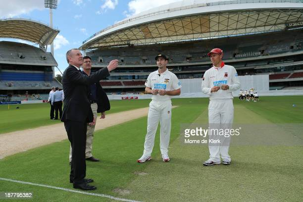 The Premier of South Australia Jay Weatherill tosses the coin with Redbacks captain Johan Botha and Warriors captain Shaun Marsh before day one of...