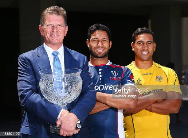 The Premier of Victoria Ted BaIllieu Kimani Situati of the Melbourne Rebels and Cooper Vuna of the Wallabies pose during a photocall with the Tom...