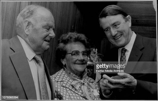 The Premier Signs a coaster for Fred and Gladys O'Keefe at last night's functionFred and Gladys O'Keefe were rewarded last night for their devotion...
